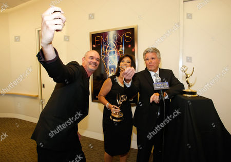 From left, David Goldstein, Colleen Williams and Chuck Henry are seen backstage at the Television Academy's 66th Los Angeles Area Emmy Awards on at The Leonard H. Goldenson Theater in the NoHo Arts District in Los Angeles
