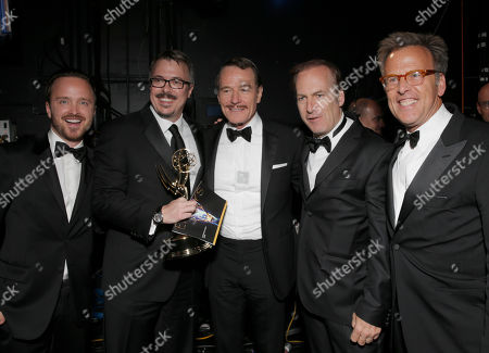 Aaron Paul, and from left, executive producer Vince Gilligan, Bryan Cranston, Bob Odenkirk and executive producer Mark Johnson are seen backstage at the 66th Primetime Emmy Awards at the Nokia Theatre L.A. Live, in Los Angeles
