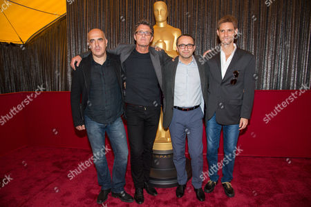 """Andrey Zvyagintsev and Damián Szifrón Directors, Zaza Urushadze, left, Pawel Pawlikowski, Andrey Zvyagintsev and Damian Szifron attend the Foreign Language Film Awards Nominees Photo Op at The Dolby Theatre, in Los Angeles. Urushadze's """"Tangerines,"""" Pawlikowski's """"Ida,"""" Zvyagintsev's """"Leviathan,"""" and Szifron's """"Wild Tales,"""" are nominated for an Oscar for best foreign film. The 87th annual Academy Awards are presented on Sunday, Feb. 22, in Los Angeles"""