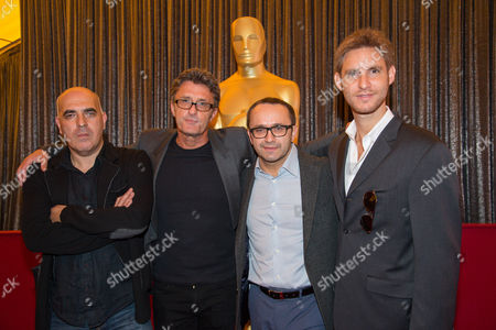 """Directors, Zaza Urushadze, left, Pawel Pawlikowski, Andrey Zvyagintsev and Damian Szifron attend the Foreign Language Film Awards Nominees Photo Op at The Dolby Theatre, in Los Angeles. Urushadze's """"Tangerines,"""" Pawlikowski's """"Ida,"""" Zvyagintsev's """"Leviathan,"""" and Szifron's """"Wild Tales,"""" are nominated for an Oscar for best foreign film. The 87th annual Academy Awards are presented on Sunday, Feb. 22, in Los Angeles"""