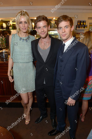 "Ruta Gedmintas, Luke Treadway and Sam Treadway are seen at the pre theatre reception for ""A Curious Night at the Theatre"" in London on"