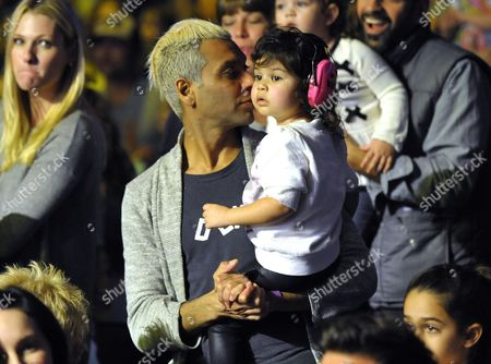 Stock Picture of Tony Kanal, left, and daughter Coco Reese Lakshmi Kanal are seen at A Very Awesome Yo Gabba Gabba! Live! Holiday Show, on at Nokia Theater, L.A. Live in Los Angeles