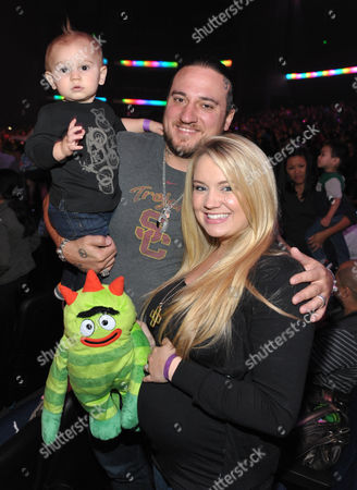 From right, Tiffany Thornton is seen with husband Christopher Carney and son Kenneth Carney at A Very Awesome Yo Gabba Gabba! Live! Holiday Show, on at Nokia Theater, L.A. Live in Los Angeles