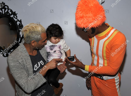 From left, Tony Kanal and daughter Coco Reese Lakshmi Kanal are seen with DJ Lance Rock at A Very Awesome Yo Gabba Gabba! Live! Holiday Show, on at Nokia Theater, L.A. Live in Los Angeles