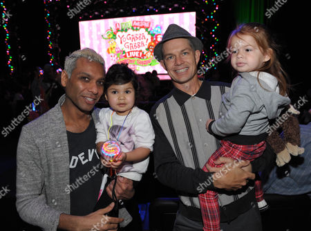 From left, Tony Kanal with daughter Coco Reese Lakshmi Kanal and Adrian Young with daughter Magnolia Renee Young are seen at A Very Awesome Yo Gabba Gabba! Live! Holiday Show, on at Nokia Theater, L.A. Live in Los Angeles