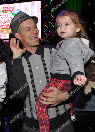 Stock Picture of Adrian Young, left, and daughter Magnolia Renee Young are seen at A Very Awesome Yo Gabba Gabba! Live! Holiday Show, on at Nokia Theater, L.A. Live in Los Angeles