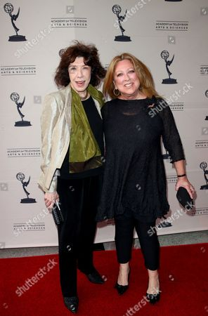 "MAY 16: Comediennes Lily Tomlin (L) and Elayne Boosler arrive at the Academy Of Television Arts & Sciences Presents: ""A Conversation With Ladies Who Make Us Laugh,"" an evening with the ladies who have made an outstanding contribution in the field of comedy, held at the Leonard H. Goldenson Theatre on in North Hollywood, California. A live webcast of the discussion can be viewed on the Academy of Television Arts & Sciences website, www.emmys.com and www.emmys.tv"