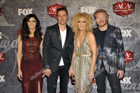 From left, Karen Fairchild, Jimi Westbrook, Kimberly Roads Schlapman and Phillip Sweet of Little Big Town arrive at the American Country Awards, in Las Vegas