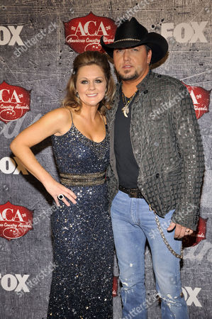 From right, recording artist Jason Aldean and his wife Jessica Aldean arrive at the American Country Awards, in Las Vegas