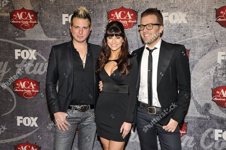From left, Mike Gossin, Rachel Reinert and Tom Gossin of Gloriana arrive at the American Country Awards, in Las Vegas