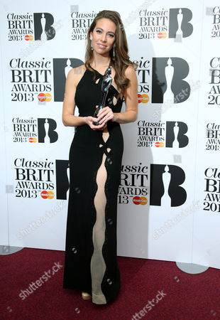 Amy Dickson poses with the MasterCard's Breakthrough Artist of the Year award at the Classic BRIT Awards 2013 at the Royal Albert Hall,, in London