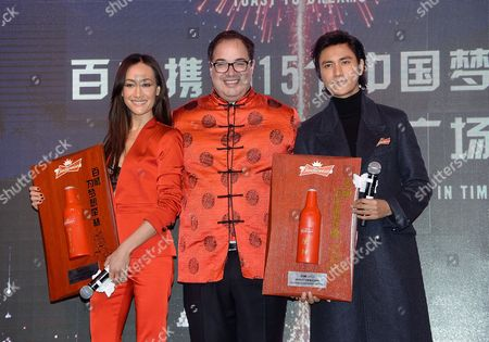"Actress Maggie Q, AB InBev chief marketing officer Miguel Patricio, center, and actor/singer Chen Kun participate in Budweiser's ""Toast To Dreams"" Chinese New Year celebration in Times Square, in New York"