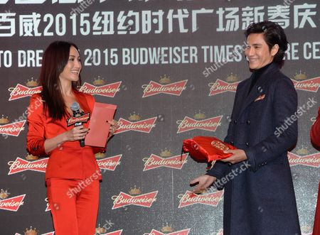"Actress Maggie Q and Chinese actor and singer Chen Kun participate in Budweiser's ""Toast To Dreams"" Chinese New Year celebration in Times Square, in New York"