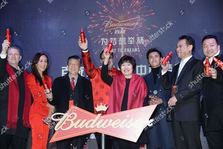 "Participates Maggie Q, Miguel Patricio, Zhang Qiyue and Chen Kun share a toast during Budweiser's ""Toast To Dreams"" Chinese New Year celebration in Times Square, in New York"