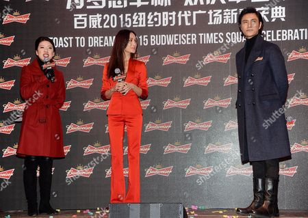 "Actress Maggie Q, center, and Chinese actor and singer Chen Kun participate in Budweiser's ""Toast To Dreams"" Chinese New Year celebration in Times Square, in New York"