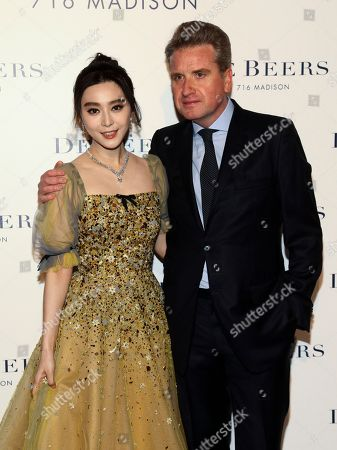 Fan Bingbing, left, and Francois Delage, right, attend the De Beers flagship store opening on Madison Avenue, in New York