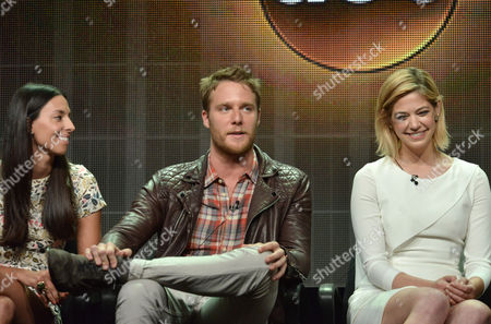 From left, Jade Catta-Preta, Jake McDorman and Analeigh Tipton speak on stage during the 'Manhattan Love Story'' panel at the Disney/ABC Television Group 2014 Summer TCA at the Beverly Hilton Hotel, in Beverly Hills, Calif