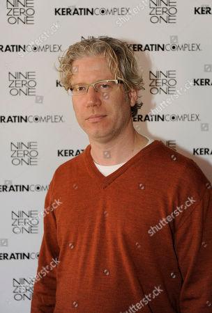 Producer Eddie Schmidt visits the Keratin Complex pop-up salon at the Fender Music lodge during the Sundance Film Festival, in Park City, Utah