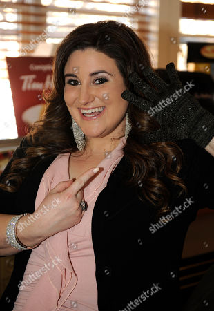 Actress KayCee Stroh wears Glider Gloves at the Fender Music lodge during the Sundance Film Festival, in Park City, Utah