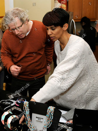 Producer Eddie Schmidt, left, and actress Marta Cunningham visit Park Lane jewelry at the Fender Music lodge during the Sundance Film Festival, in Park City, Utah