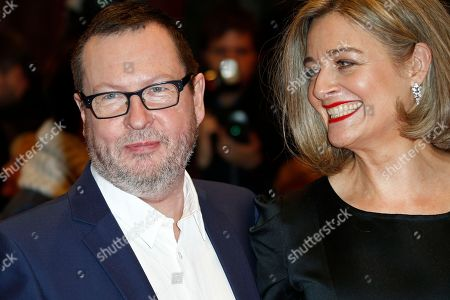 Director Lars von Trier and his wife Bente Froge pose for photographers on the red carpet for the film Nymphomaniac at the International Film Festival Berlinale in Berlin