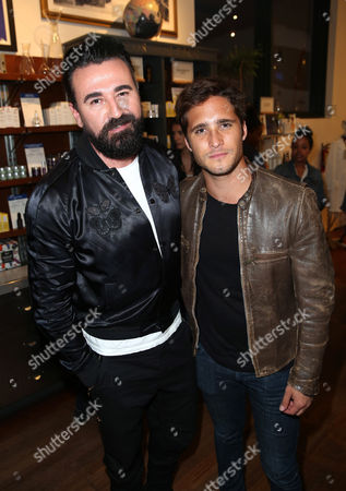 President of Kiehl's U.S. Chris Salgardo, left, and Diego Boneta attend the Kiehl's Earth Day Celebration with Nikki Reed to Benefit Recycle Across America at Kiehl's Since 1851 on in Santa Monica, Calif