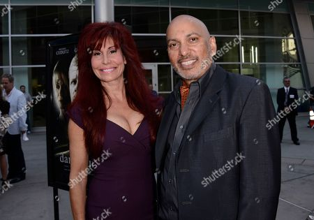 "Producer Suzanne DeLaurentiis, left, and director Suri Krishnamma arrive on the red carpet at the premiere of the feature film ""Dark Tourist"" at the ArcLight Cinemas on in Los Angeles"