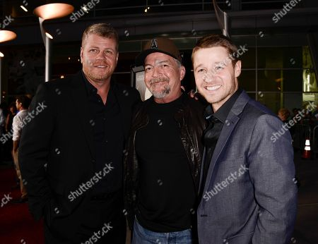 """Stock Image of Actor Michael Cudlitz, left, producer and writer Christopher Chulack, center, and actor Benjamin McKenzie arrive on the red carpet at the premiere of the feature film """"Dark Tourist"""" at the ArcLight Cinemas on in Los Angeles"""