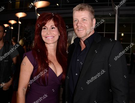 "Actor Michael Cudlitz, right, and producer Suzanne DeLaurentiis arrive on the red carpet at the premiere of the feature film ""Dark Tourist"" at the ArcLight Cinemas on in Los Angeles"