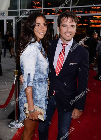 """Actor Matthew Settle, right, and his unidentified guest arrive on the red carpet at the premiere of the feature film """"Dark Tourist"""" at the ArcLight Cinemas on in Los Angeles"""
