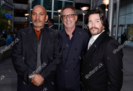 """Stock Image of From left to right, director Suri Krishnamma, producer Ivan Kavalsky, and writer Frank John Hughes arrive on the red carpet at the premiere of the feature film """"Dark Tourist"""" at the ArcLight Cinemas on in Los Angeles"""