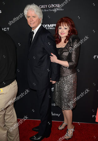 "Naomi Judd, right, and Larry Strickland arrive at the LA premiere of ""Olympus Has Fallen"" at the ArcLight Theatre on in Los Angeles"