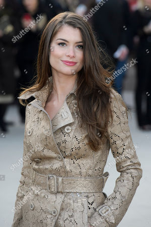 Stock Photo of Alinne Moraes arrives for the Burberry Prorsum fashion collection during London Fashion Week, at a central London Venue, London