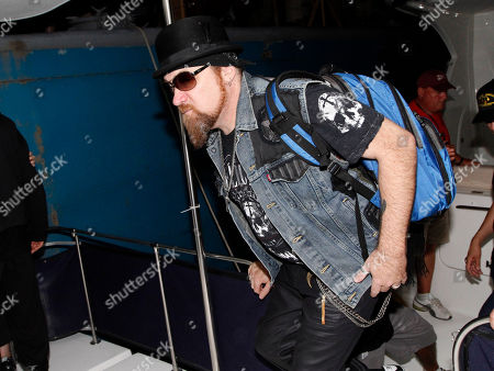 """Southern rockers Lynyrd Skynyrd performed at the Riverbend Festival, in Chattanooga, TN. Peter """"Keys"""" Pisarczyk arriving at the stage by boat"""