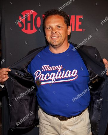 Kevin Chapman lifts his jacket to show his support for Manny Pacquiao at the Mayweather VS. Pacquiao VIP Pre-Fight Party at MGM Grand, in Las Vegas, Nev