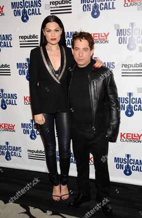 Singer Jessie J poses with Republic Records executive vice president Charlie Walk at the Musicians On Call 15th Anniversary at Espace, in New York