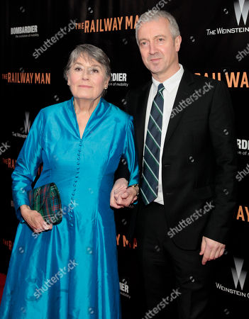 """Film subject Patti Lomax, left, and producer Andy Paterson, right, attend the New York premiere of """"The Railway Man"""", in New York"""