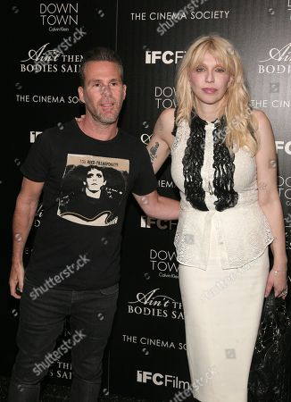 "CEO of One Management Scott Lipps, left, and musician Courtney Love, right, attend a screening of IFC Films' ""Ain't Them Bodies Saints"" presented by Downtown Calvin Klein with The Cinema Society on in New York"