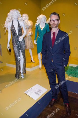 """Costume designer Michael Wilkinson attends the 22nd annual Art of Motion Picture Costume Design Exhibit, in Los Angeles, Calif. Wilkinson's costumes for the film """"American Hustle,"""" are nominated for an Academy Award. The Fashion Institute of Design & Merchandising holds its free-to-the-public Art of Motion Picture Costume Design exhibit on view until April 26, 2014, featuring this year's five Oscar nominees: """"American Hustle,"""" """"The Grandmaster,"""" """"The Great Gatsby,"""" """"The Invisible Woman"""" and """"12 Years A Slave,"""" in Los Angeles"""