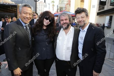 Stock Image of Chairman and Chief Executive Officer, Warner Bros. - Kevin Tsujihara, Fran Walsh, Peter Jackson and Andy Serkis seen at a ceremony honoring Peter Jackson with a star on The Hollywood Walk Of Fame, in Los Angeles, CA