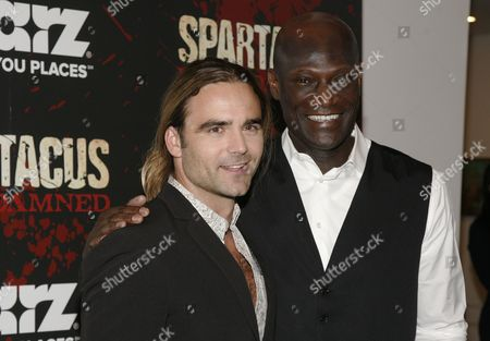 "Actor Dustin Clare, left, and actor Peter Mensah, right, attend the ""Spartacus: War of the Damned"" premiere, at the Musuem of Modern Art on in New York"