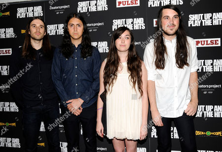"""Members of the band Cults, from left, Marc Deriso, Nathan Aguilar, Madeline Follin and Brian Oblivion attend a special screening of """"Shut Up And Play The Hits"""" at the Village East Theater on in New York"""