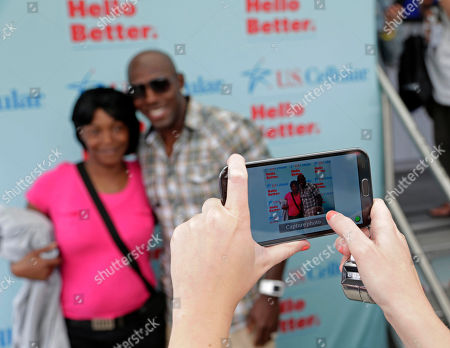 Green Bay Packer all-time leading receiver, Super Bowl Champion and Dancing with the Stars Champion Donald Driver takes pictures with fans during Summerfest, on behalf of U.S. Cellular. in Milwaukee, Wis