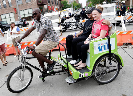 Green Bay Packer all-time leading receiver, Super Bowl Champion and Dancing with the Stars Champion Donald Driver surprises Summerfest attendees with free pedi-cab rides on behalf of U.S. Cellular in Milwaukee, Wis
