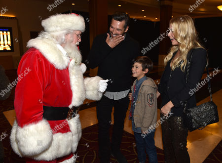 Santa Claus, and from left, Eddie Cibrian, Jake Cibrian, and LeAnn Rimes attend The Grove's 12th Annual Christmas Tree Lighting Spectacular Presented By Citi at The Grove on in Los Angeles, California