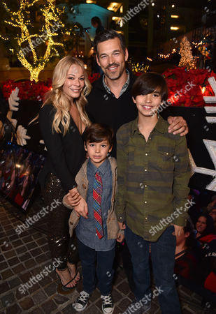 LeAnn Rimes, and from left, Eddie Cibrian, Jake Cibrian, and Mason Cibrian attend The Grove's 12th Annual Christmas Tree Lighting Spectacular Presented By Citi at The Grove on in Los Angeles, California