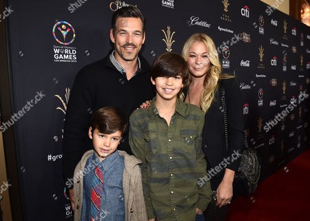Stock Photo of Eddie Cibrian, and from left, Jake Cibrian, Mason Cibrian, and LeAnn Rimes arrive at The Grove's 12th Annual Christmas Tree Lighting Spectacular Presented By Citi at The Grove on in Los Angeles, California