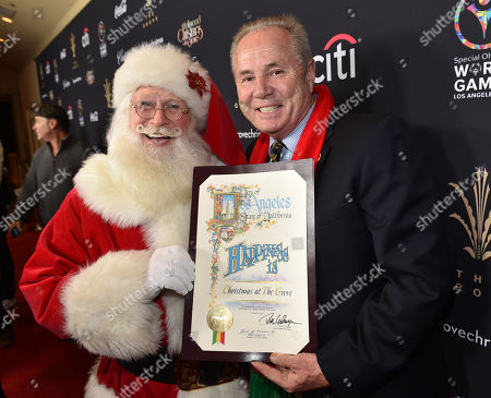Santa Claus, left, and Congressman Tom LaBonge arrive at The Grove's 12th Annual Christmas Tree Lighting Spectacular Presented By Citi at The Grove on in Los Angeles, California