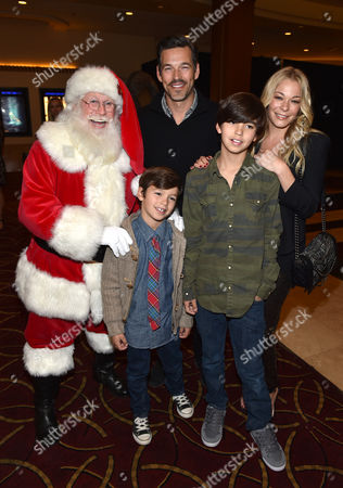 Santa Claus, and from left, Eddie Cibrian, Jake Cibrian, Mason Cibrian, and LeAnn Rimes attend The Grove's 12th Annual Christmas Tree Lighting Spectacular Presented By Citi at The Grove on in Los Angeles, California