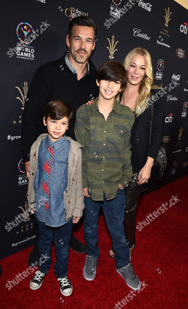 Eddie Cibrian, and from left, Jake Cibrian, Mason Cibrian, and LeAnn Rimes arrive at The Grove's 12th Annual Christmas Tree Lighting Spectacular Presented By Citi at The Grove on in Los Angeles, California